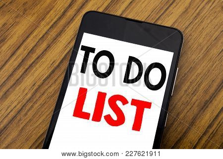 Word, Writing Handwriting To Do List. Business Concept For Plan Lists Remider Written On Mobile Phon
