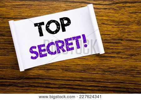 Word, Writing Top Secret. Business Concept For Military Top Secret Written On Sticky Note Paper On W