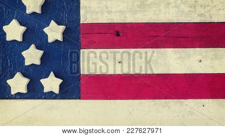 Close Up Of A Wooden American Flag Using As Background