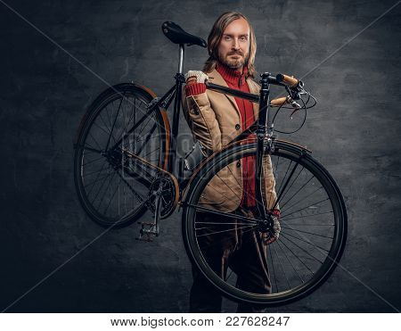 Hipster Man With Long Blond Hair Holds Single Speed Bycycle On His Shoulder.