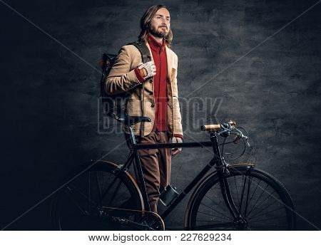 A Traveler Hipster Man With Long Blond Hair, Wearing Yellow Jacket Posing With Authentic Single Spee