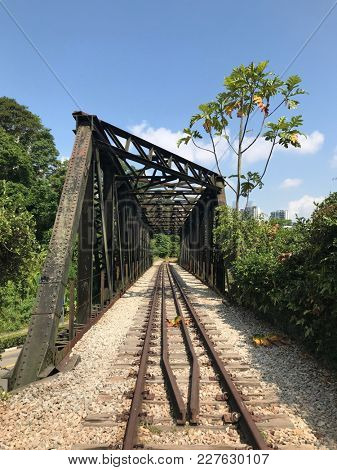 Old disused railway bridge with railway track and sleepers intact, once belonging to Keretapi Tanah Melayu,  in Bukit Timah, Singapore.