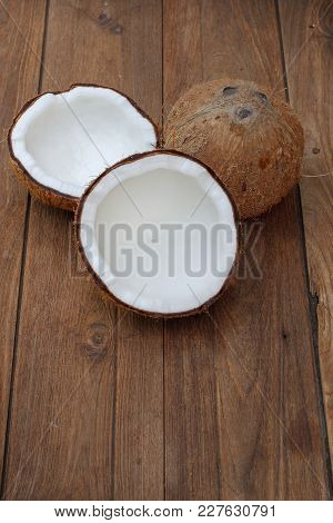 Coconut Isolated On The Wooden Background. Tropical Fruit Coconut.