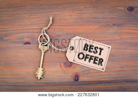 Best Offer. Key And A Note On A Wooden Table With Text.