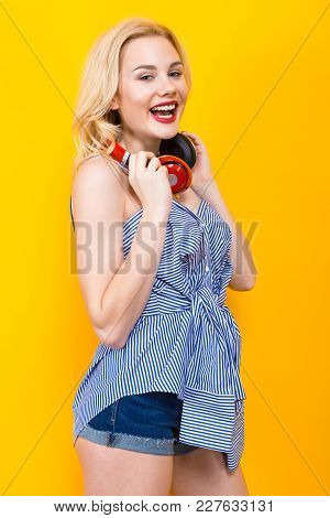 Attractive Blonde Cheerful Woman Dj With Red Lips In Blue Striped Shirt On Orange Background Hold Re