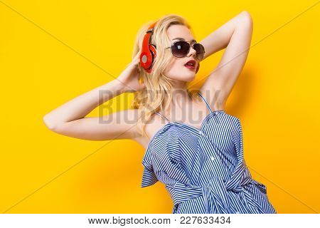 Blonde Attractive Woman Dj With Red Lips In Blue Striped Shirt And Sunglasses On Yellow Background W