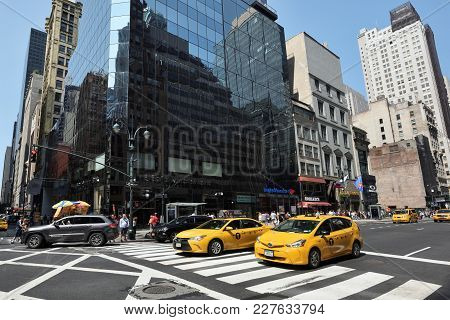 New York City, Usa - Aug. 26: Yellow Taxis On Street In Manhattan On August 26, 2017 In New York Cit