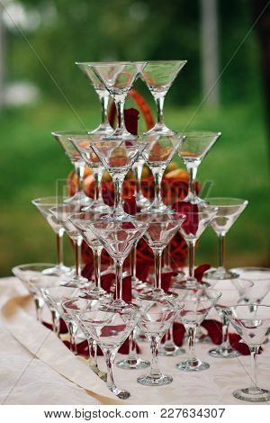 Pyramid Of Glasses For Martini And Champagne For A Festive Reception At The Wedding On The Table