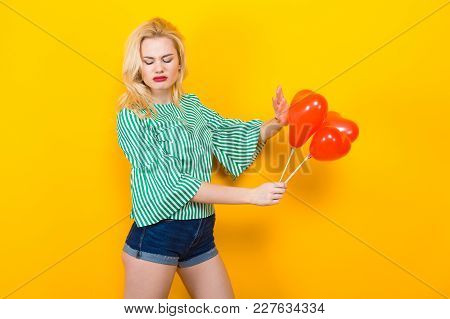 Portrait Of Woman In Striped Shirt And Jeans Shorts Isolated On Orange Background With Copyspace Sho
