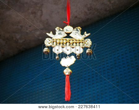 A Chinese Lucky Charm Hanging Above The Doorway