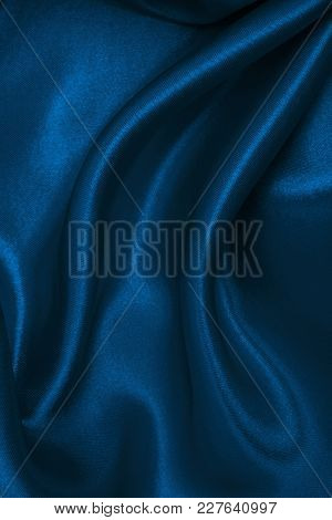 Smooth Elegant Blue Silk Or Satin Luxury Cloth Texture As Abstract Background. Luxurious Christmas B