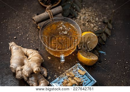 Yellow Colored Lemon Ginger Tea With All Its Ingredients In Dark Gothic Colors.lemon Ginger Tea Impr