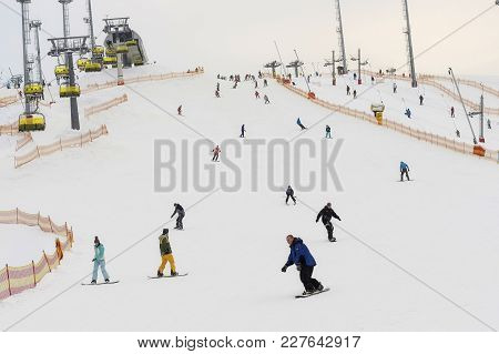St-petersburg, Russia - February 11, 2018: Ski Slope With Descending. Alpine Skiers And Snowboarders