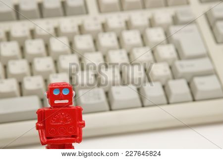 Robot Or Artificial Intelligence And Pc Keyboard On White Background. Concept Of Artificial Intellig