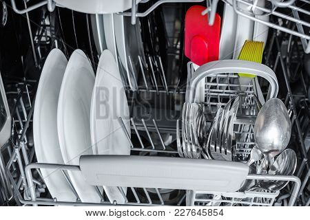 Clean Dishes In Basket Of Dishwasher After Washing