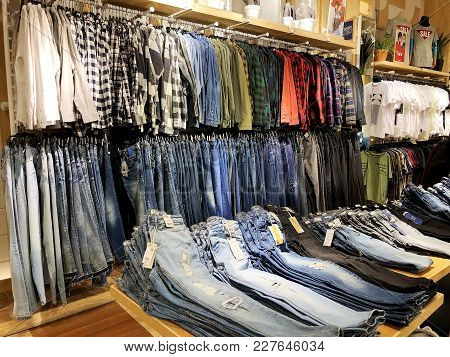 Rishon Le Zion, Israel- January 3, 2018: Modern Clothes In A Shop On A Hanger. Shirts And Sweaters O
