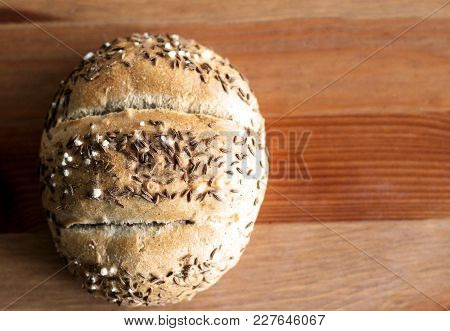 Tasty Freshly Baked Butter Kaiser Roll With Linseed And Sunflower Seeds. Top View, Copy Space, Selec