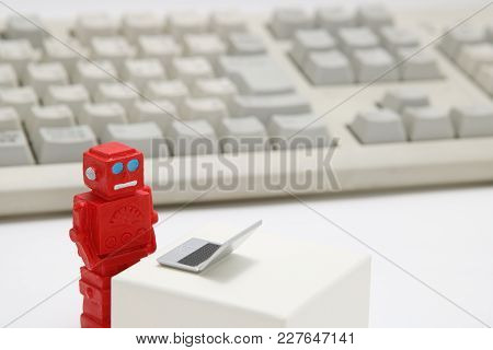 Robot Or Artificial Intelligence And Laptop With The Keyboard On White Background. Concept Of Artifi