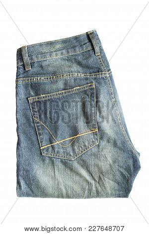 Folded Blue Worn Jeans Isolated Over White