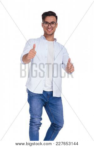 young smart casual man wearing glasses makes the ok sign on white background