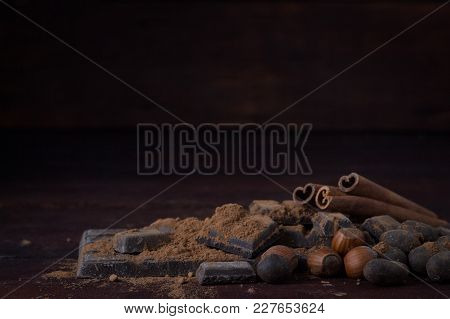 Black Chocolate, Spices, Tea Spoon, Cocoa On The Wooden Background.
