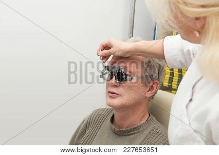Mature Man Visits An Ophthalmologist. Eyesight Check
