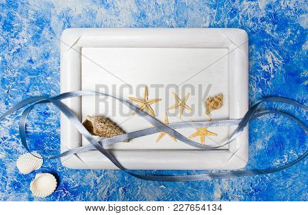 Seaside Objects In A Photo Frame Against Blue Background