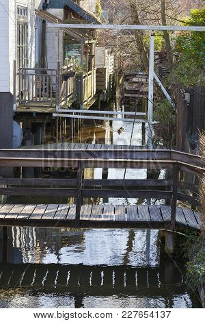 Small Wooden Bridges Over A Canal In Boskoop In The Netherlands