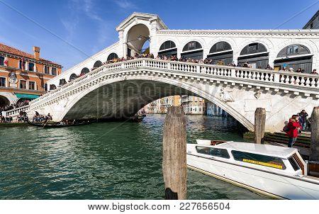 Venice, Italy - February 11: Gondolas And Rialto Bridge At Grand Canal On February 11, 2018 In Venic
