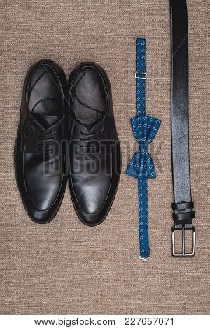 Blue Bow Tie, Leather Black Shoes And Belt. Grooms Wedding Morning. Close Up Of Modern Man Accessori
