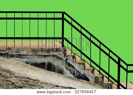 Tiled Stairs And Steel Railing With Green Concrete Wall