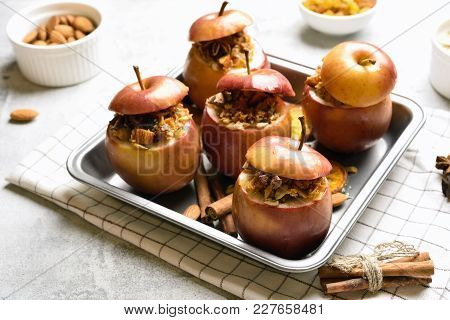 Healthy Fruit Dessert. Baked Apples With Granola, Cinnamon, Nuts And Honey. Vegetarian Food.