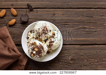 Tasty Chocolate Ice Cream With Nuts On Wooden Background With Copy Space. Top View, Flat Lay