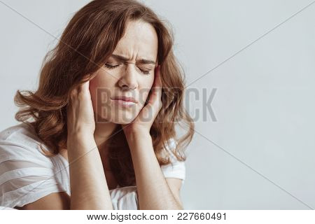Need To Take Some Pills. Cannot Stand This Pain. Portrait Of A Mature Brunette Closing Her Eyes And