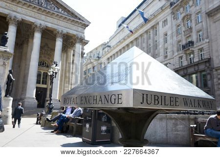 LONDON - MAY, 2017: Royal Exchange building, left, and Jubilee Walkway sign, Royal Exchange Square, London, EC3.
