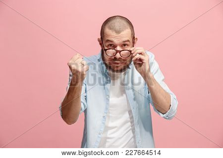 Angry Man Looking At Camera. Aggressive Business Man Standing Isolated On Trendy Pink Studio Backgro