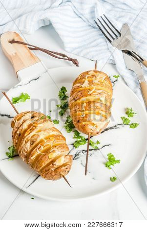 Tornado Cheesy Potatoes With Parsley And Tomatoes, On White Marble Background, Copy Space