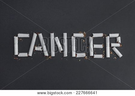 Cancer Is An Inscription Word Made From Broken Cigarettes To Visualize The Harm Of Smoking. Against