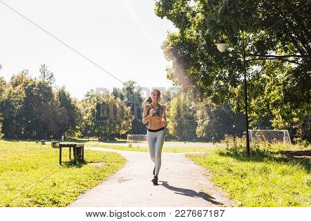 Healthy Lifestyle Young Fitness Woman Running Outdoors.