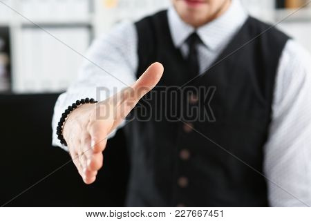 Man In Suit And Tie Give Hand As Hello In Office Closeup. Friend Welcome Mediation Offer Positive In