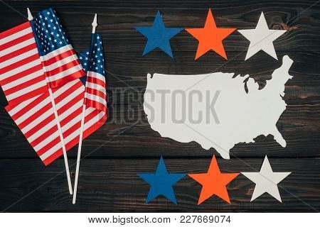 Top View Of Arranged American Flags, Piece Of Map Made Of Paper And Stars On Wooden Surface, Preside