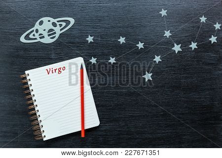 Zodiacal Star, Constellations Virgo On A Black Background With A Notepad And Pencil.