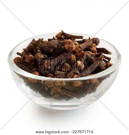 Whole Cloves In Glass Bowl Isolated On White.