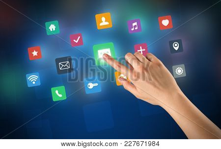 Female hand touching colorful applications