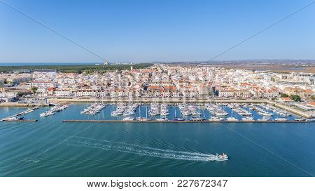 Aerial. The Village On The River Guadiana, With A Port For Yachts And Fishing Boats.