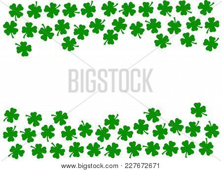 St Patrick's Day background, double side border of dark green quatrefoils isolated on white background, St Patrick's day concept. Shamrock background for St Patrick's day holiday