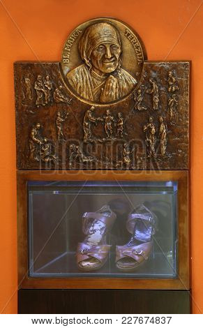 ZAGREB, CROATIA - MARCH 31: Relief with scenes from the life of Saint Mother Teresa of Calcutta and her sandals exposed in Chapel of Saint Dismas in Zagreb, Croatia on March 31, 2015