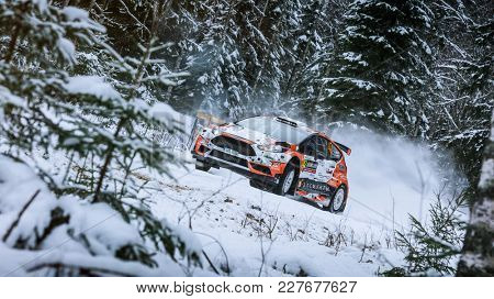 VARGASSEN, SWEDEN - 02-11-2017:  Alexey Lukyanuk with his Ford WRC car during the event Rally Sweden 2017