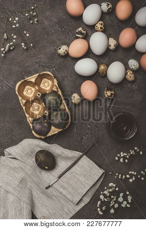 Top View Of Easter Eggs In Golden Tray, Quail And Chicken Eggs, Paint And Brush On Cloth And Concret