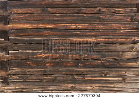 The Wall Of An Old Log House. Background